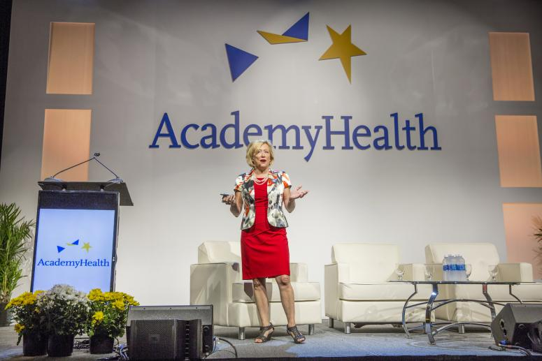 AcademyHealth CEO Lisa Simpson presenting