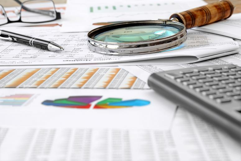 Accounting Tools, financial data and charts on the Table