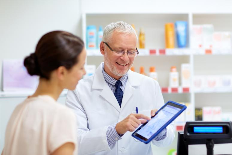 senior apothecary and female customer with digital prescription on tablet pc computer screen at pharmacy