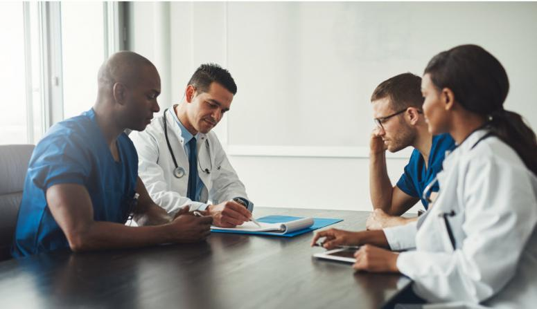 doctors collaborating at a table